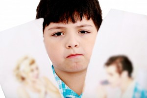 2802589-upset-boy-standing-in-front-pcture-of-parents-with-problems-against-white-background